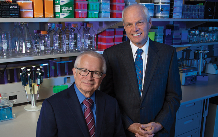 Arizona bioscience community honors two of TGen's top scientists